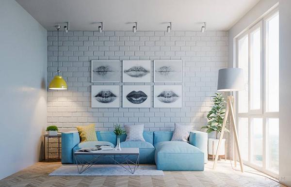 Sofa xanh kết hopwj tường gạch pastel xanh nhẹ khiến không gian trở nên thơ mộng, lãng mạn