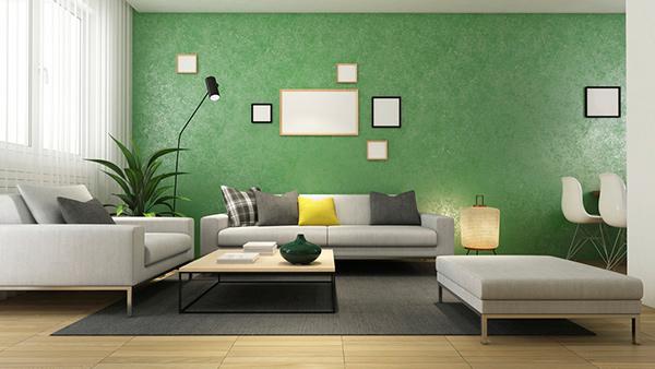Tường xanh kết hợp với sofa xám