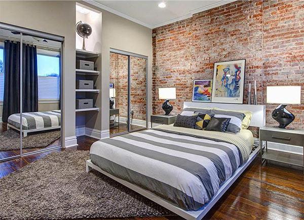 Tường phòng ngủ bằng gạch thô là chất liệu điển hình của phong cách Urban