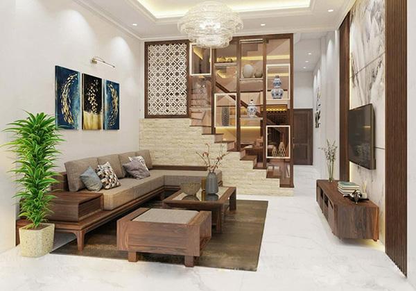 Chất liệu gỗ được sử dụng trong thiết kế phòng khách nhà ống tạo nên vẻ đẹp sang trọng